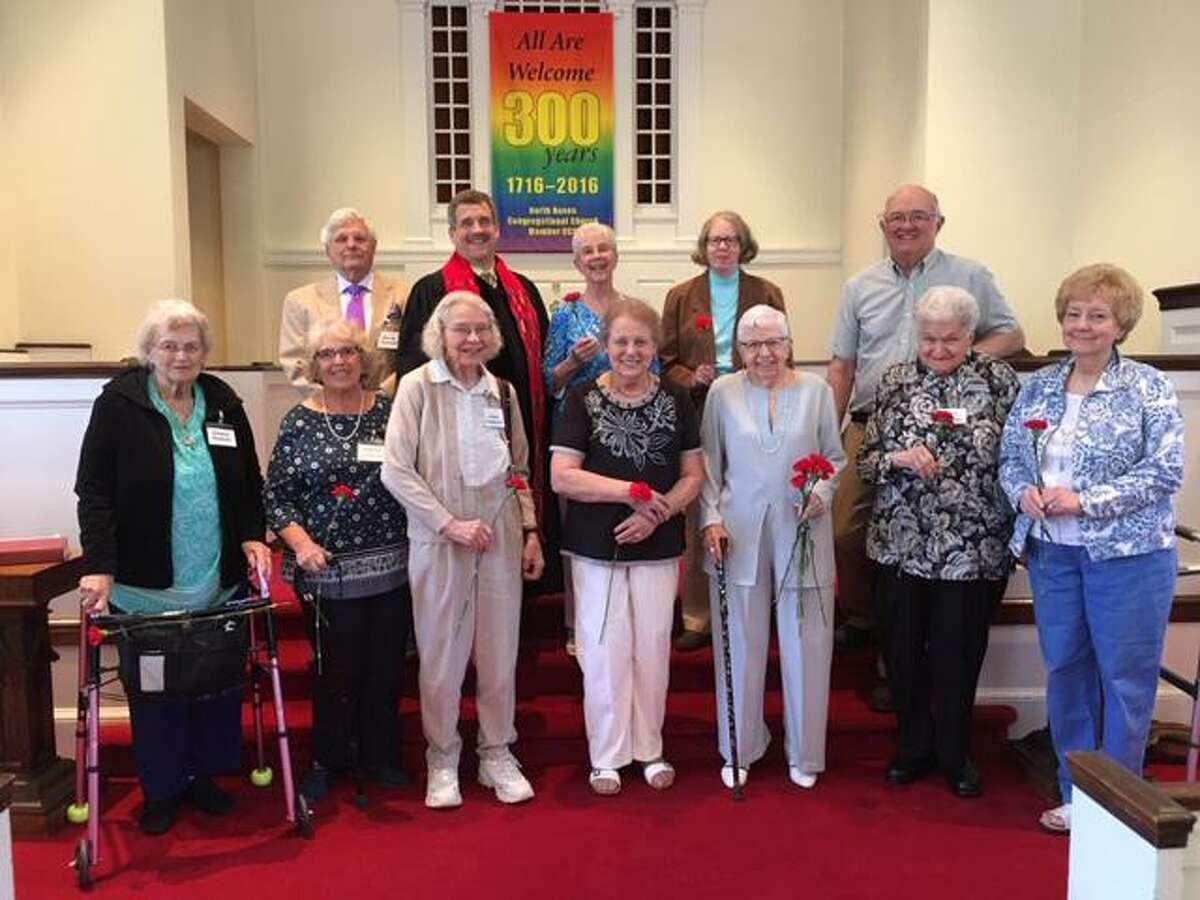 Front row, from left, are Eleanor Norback, Merrilee Gladkosky, Lillian Flodquist, Elfie Hummel, Ellie Harple, Joyce Bellonio and Linda Lacobelli; back row, from left, Bernie Hummel, Rev. Scott Morrow, Doris Ferner, Jeanne Reardon and Bryant Munson