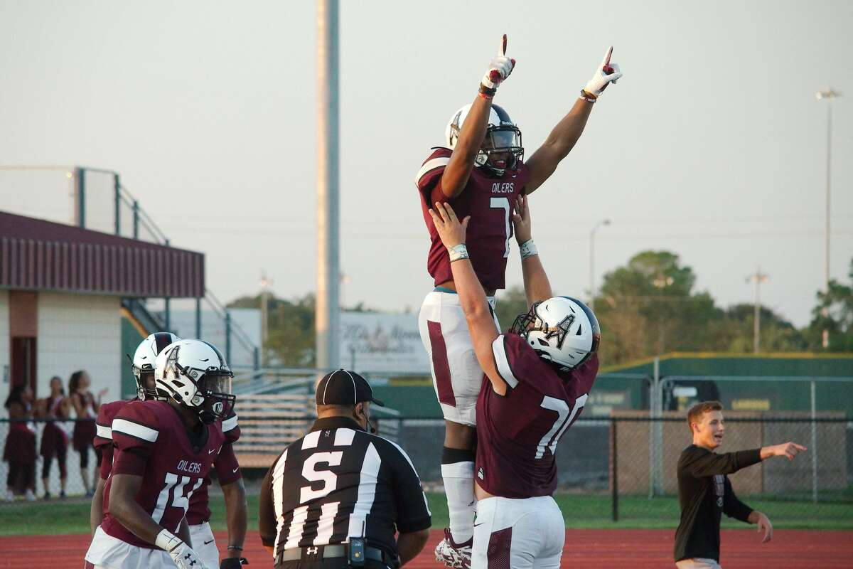 Pearland's Brandon Campbell (7) and Pearland's Seth King (70) celebrate a touchdown against Cy-Springs Thursday, Aug. 29 at Pearland High School.