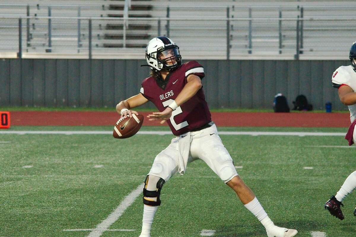 Pearland's Jd Head (2) drops back to pass against Cy-Springs Thursday, Aug. 29 at Pearland High School.