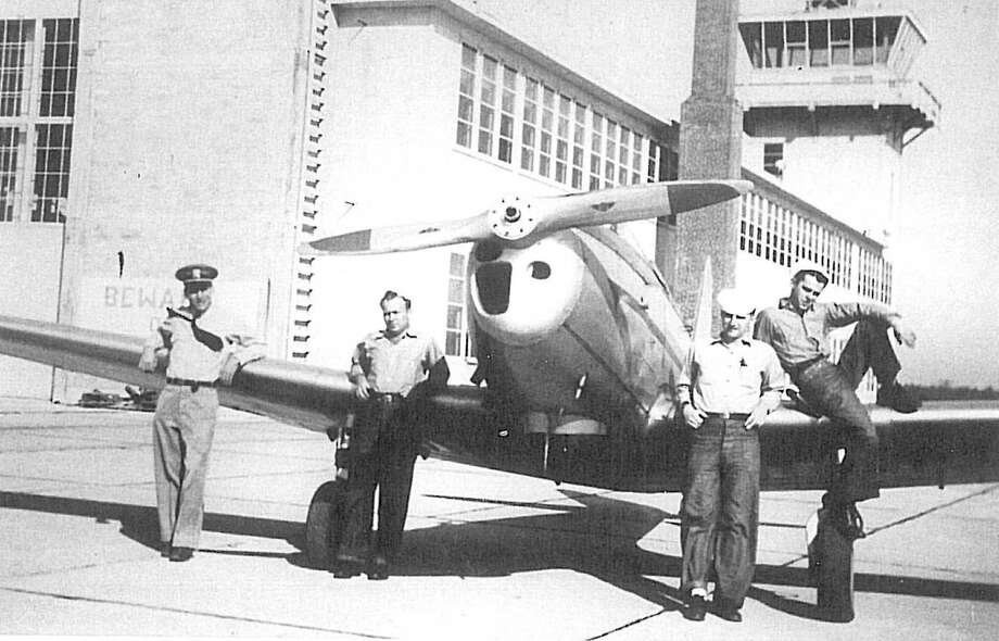 A photo taken at an Open House at the Conroe Airport in 1945 during World War II. The airport was controled by the US Navy during World War II. The thought is that the Navy put the airport there to protect the Conroe oil field from the Germans during the war. After the war, it was turned over to the county. / Stratford Booster Club