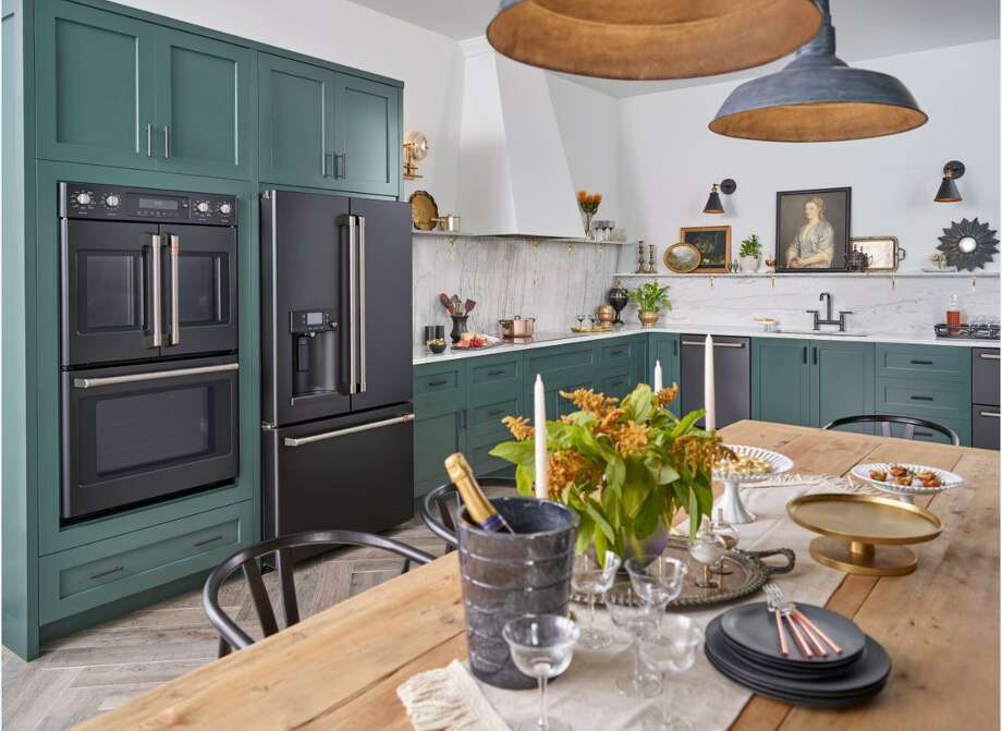 Homeowners can stamp their kitchens with personality through a variety of materials and products, such colored cabinetry, decorative accessories, artwork, and customizable appliances like these from the GE Café collection. Photo: GE Appliances / Connecticut Post