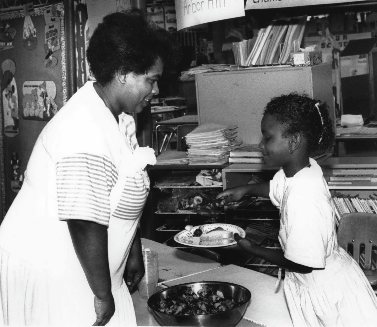 Arbor Hill Elementary School, Albany, New York - 2nd grade students serve their mothers lunch for Mothers Day - Margaret Leon with Shawan Lumpkin (age 8). Shawan serves her mother lunch. May 06, 1988 (Arnold LeFevre/Times Union Archive)