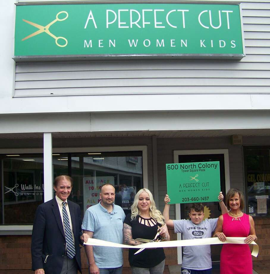 A CUT ABOVE: From left, Wallingford Mayor William Dickinson; Eli Miller; owner Deirdre Miller and son; and Quinnipiac Chamber of Commerce Executive Director Dee Prior-Nesti celebrate the grand opening of A Perfect Cut, 600 N. Colony Road in Wallingford. The shop offers fashionable cuts for men, women and children; senior and veteran discounts are available. Photo: Contributed Photo
