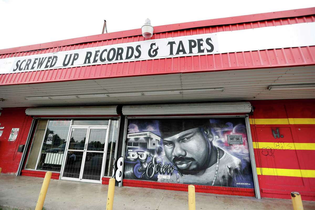 Exterior mural painting of DJ Screw at Screwed Up Records and Tapes, at 3538 W Fuqua, Friday, Sept. 2, 2016 in Houston. Robert Earl Davis aka DJ Screw did only a few interviews during his short lifetime, he died in 2000, and also wasn't often photographed. He opened up Screwed Up Records and Tapes, in the late 1990s. ( Karen Warren / Houston Chronicle )