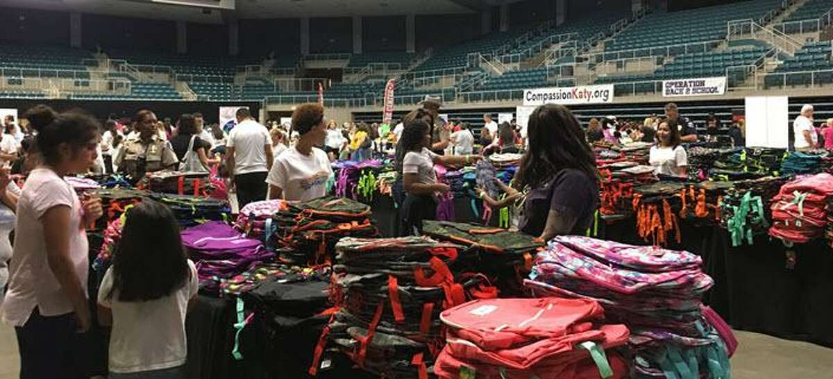 Tables filled with backpacks offered students and their families who participated in the Aug. 3 Operation Back 2 School at the Merrell Center in Katy a variety from which to choose.