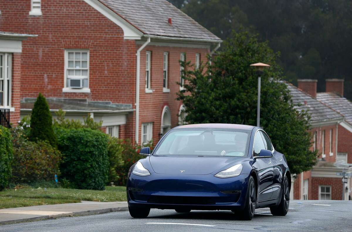 Ross Marabella drives his Tesla Model 3 through the Presidio in San Francisco, Calif. on Friday, June 14, 2019. New figures show that 13% of all vehicles registered in the Bay Area last year were electric, up from 7% in 2017.