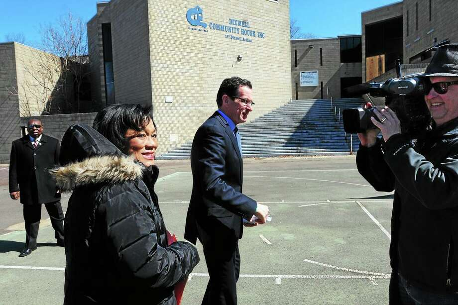 """(Peter Hvizdak-New Haven Register) ¬ Gov. Dannel P. Malloy and New Haven Mayor Toni Harp, left, walk to the podium past the blighted Dixwell Community """"Q""""-House Harp Tuesday, March 18, 2014 to announce that the state will assist the City of NewHaven in funding the construction of a new community center. Photo: Peter Hvizdak / New Haven Register / ©Peter Hvizdak /  New Haven Register"""