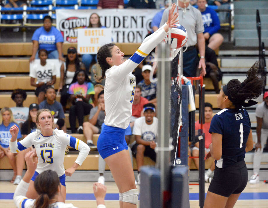 Wayland Baptist's Kellie Kozak tries to put the ball down at the net after a hit from the University of the Southwest's Martinique Larvinga during their volleyball match on Wednesday night in the Hutcherson Center. Also pictured is Wayland's Amber Daniel. Photo: Nathan Giese/Planview Herald