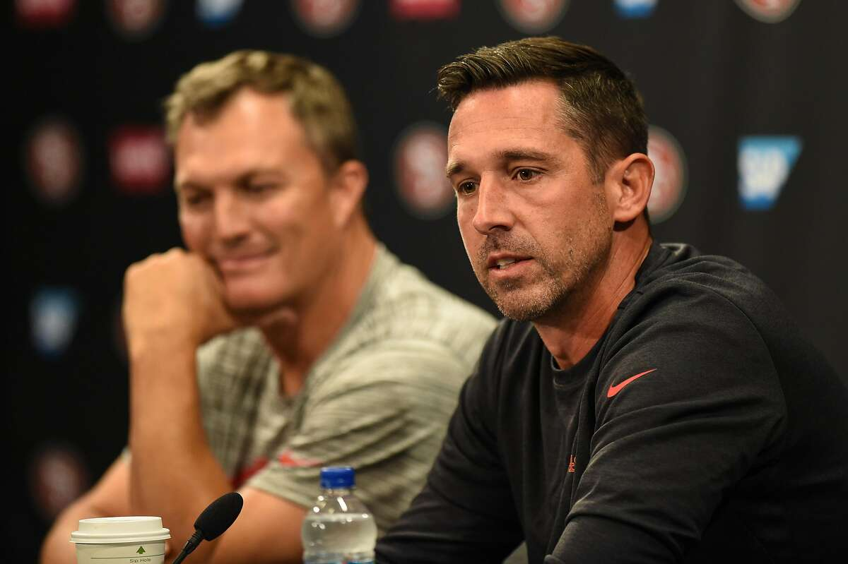 San Francisco 49ers head coach Kyle Shanahan, right, and general manager John Lynch are both aware of their good fortune after the salary cap fell by $15.6 million per team because of lost revenue from the pandemic-impacted 2020 season.