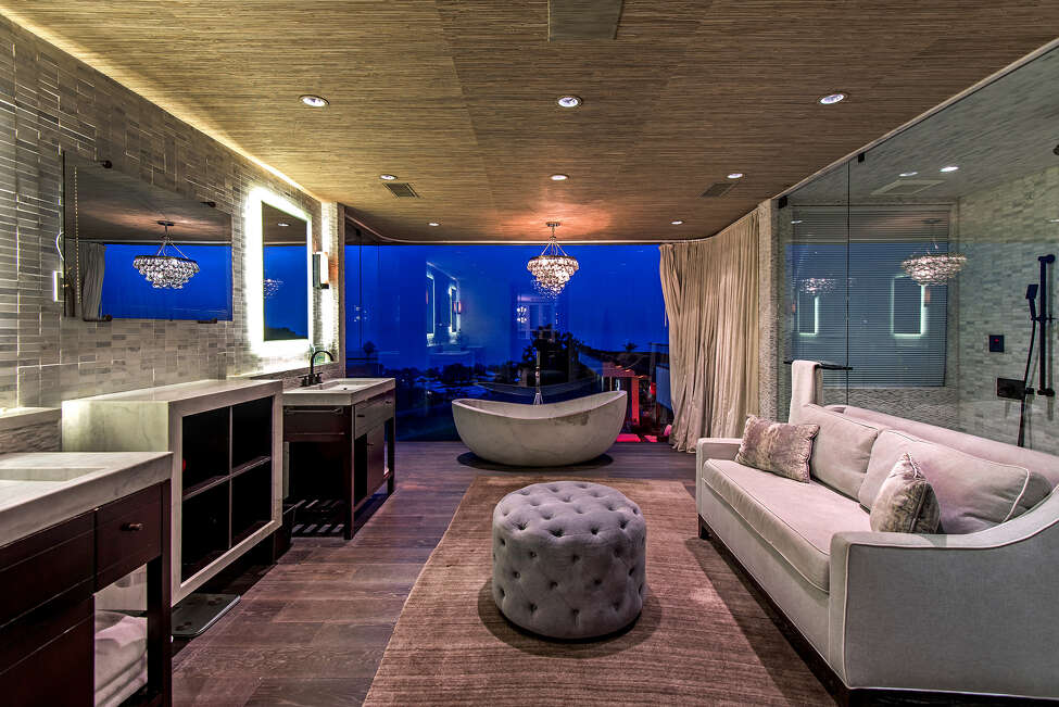 Former NFL star Reggie Bush is seeking $9.995 million for his Pacific Palisades home of five years. The contemporary-style house was extensively renovated six years ago and features bifolding walls of glass, polished wood details and stone surfaces. The indoor-outdoor living room doubles as a home theater with blackout curtains. Outside, the Bush residence features an infinity-edge swimming pool, a firepit, a deck/lounge and a built-in barbecue. Panoramic views of the ocean and city lights are on full display. (Jeff Elson/Handout/TNS)