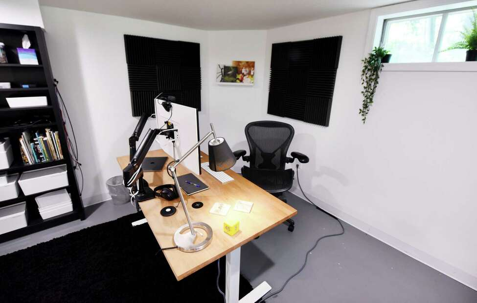 Jason Morris's basement home office on Friday, Aug. 23, 2019, in Ballston Spa, N.Y. Website developers, Jason and wife, Katy DeCorah, renovated their basement to make their own home offices. (Will Waldron/Times Union)