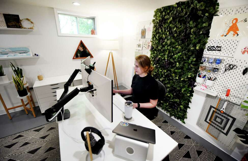 Katy DeCorah works in her basement home office on Friday, Aug. 23, 2019, in Ballston Spa, N.Y. Website developers, Katy Decorah and husband her husband, Jason Morris, renovated their basement to make their own home offices. (Will Waldron/Times Union)
