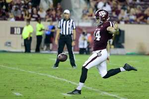 Texas A&M punter Braden Mann (34) punts the ball against Texas State during the second half of an NCAA college football game, Thursday, Aug. 29, 2019, in College Station, Texas. (AP Photo/Sam Craft)