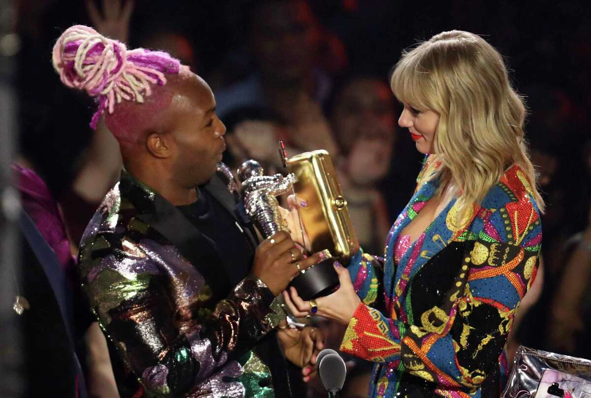 Todrick Hall, left, and Taylor Swift accept the video for good award for