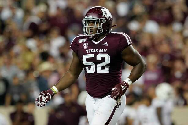 Texas A&M's Justin Madubuike (52) celebrates after a play against Texas State during the first half of an NCAA college football game in College Station, Texas, Thursday, Aug. 29, 2019. (AP Photo/Chuck Burton