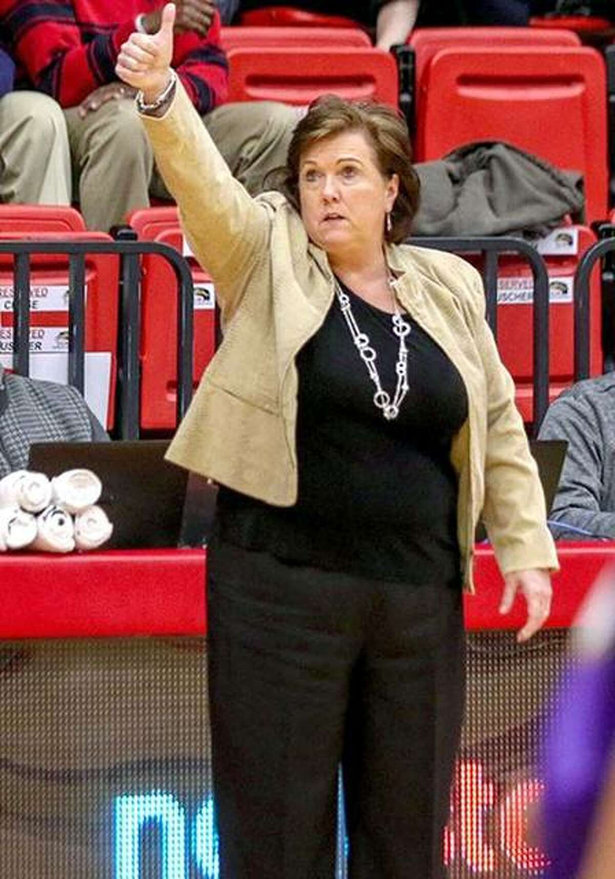 SIUE women's basketball coach gives a thumbs up to her team during a game last season. The Cougars' 2019-20 schedule has been released and Buscher calls the slate 'balanced.'