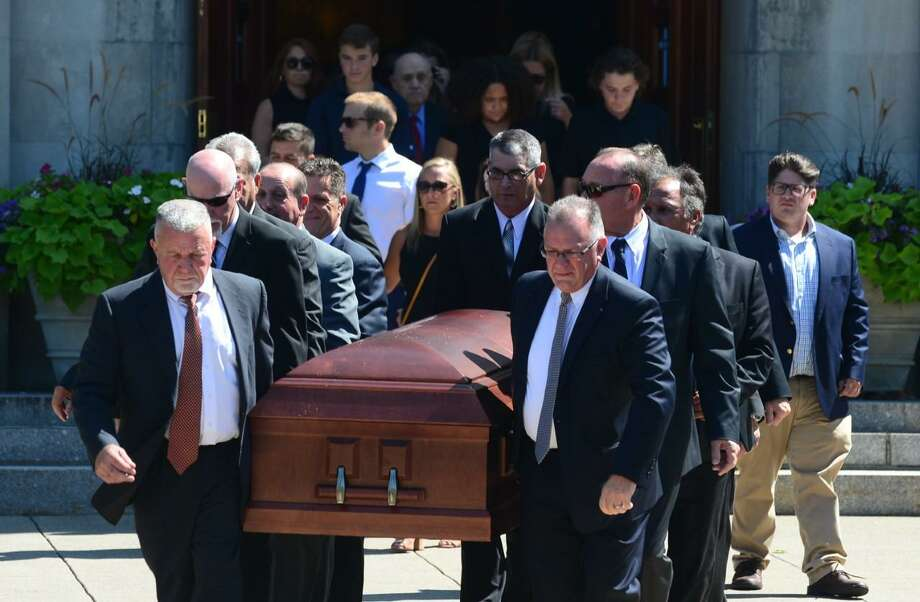 Family members bear the casket of Tim Currie, a beloved Norwalk business owner and musician, outside of St. Thomas the Apostle Church on Friday, Aug. 30, 2019. Photo: Erik Trautmann / Hearst Connecticut Media