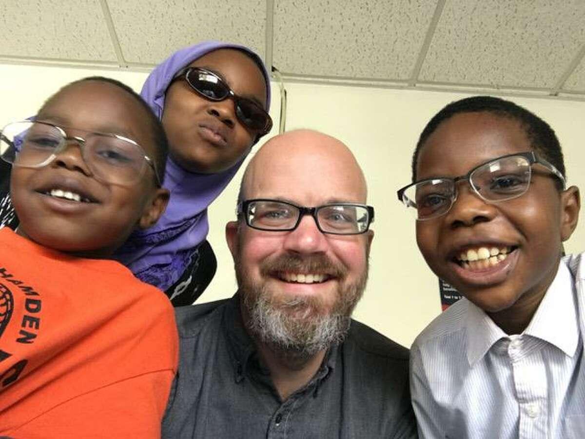 Dennis Wilson (center) with IRIS students Abdoulhalim, Manayil, and Abdelaziz Yaya.