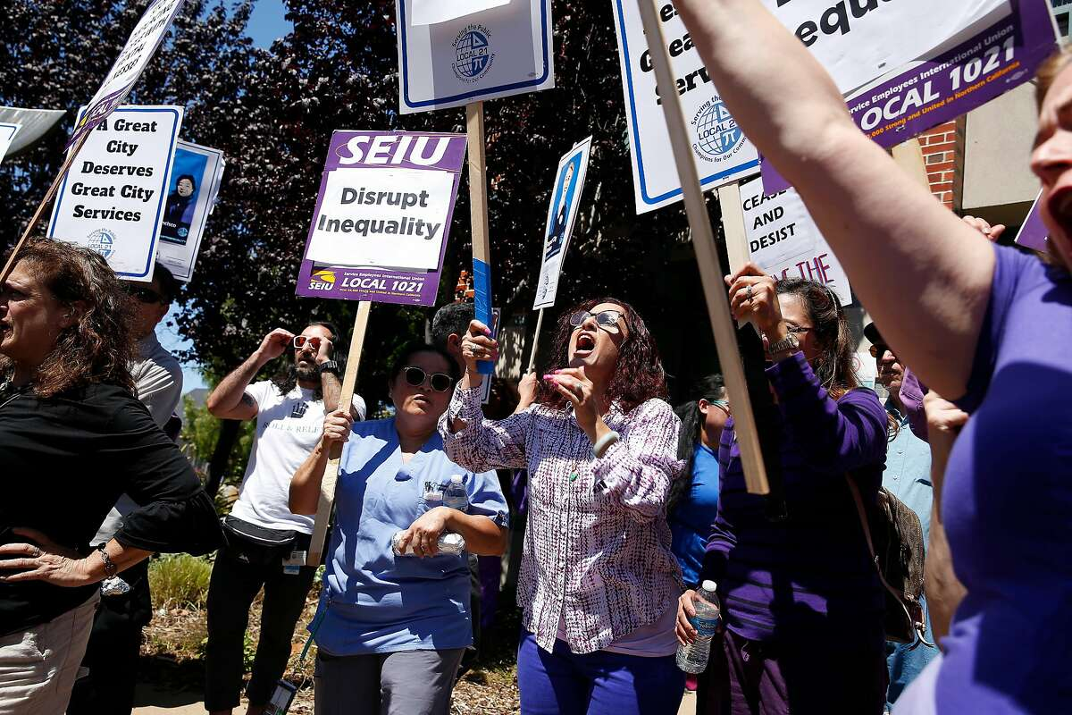 Staff members at the Zuckerberg San Francisco General Hospital's adult residential facility at a rally at the Behavioral Health Center at 887 Potrero Avenue on August 22, 2019 in San Francisco, CA. The hospital's former chief of psychiatry, Robert Okin, argues that San Francisco's cuts to mental illness services over the past several years add up to a war on mentally ill people.