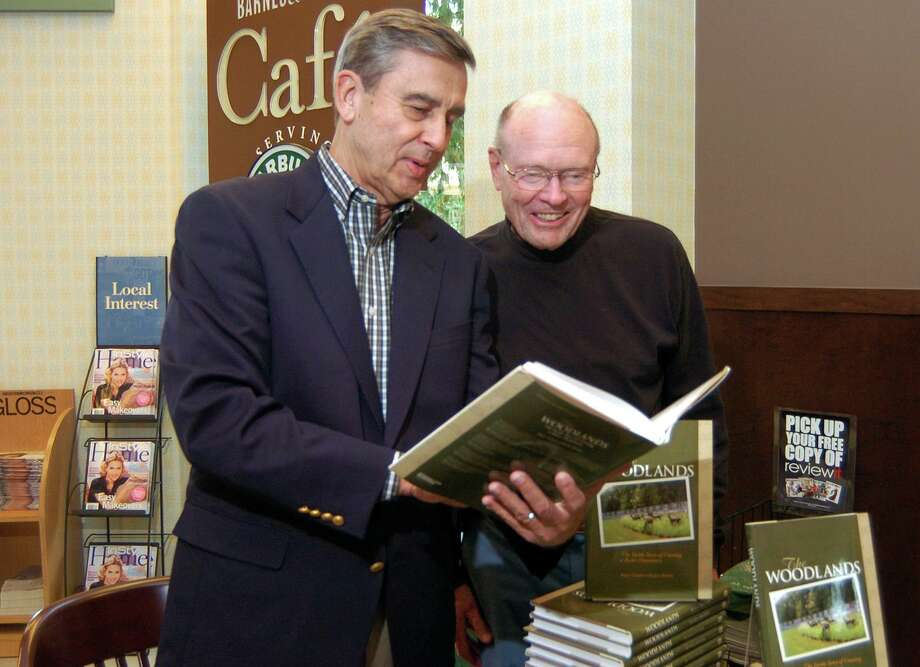 """Roger Galatas and Al Kintigh, The Woodlands, look for a passage in Galatas's new book. Galatas, author of """"The Inside Story of Creating a Better Hometown,"""" died Thursday, Aug. 29, at 83 years of age. Photo: David Hopper, Freelance / For The Chronicle / Freelance"""