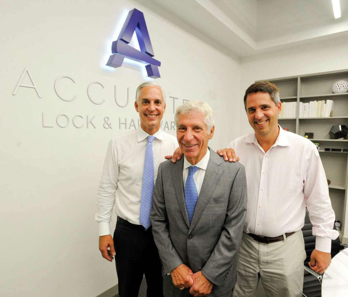 From left, Accurate Lock & Hardware's CEO, Reed Salvatore; chairman Ronald Salvatore; and vice president Rodd Salvatore are photographed on Aug. 28, 2019 at their company's headquarters at 1 Annie Place, on the West Side of Stamford, Conn.