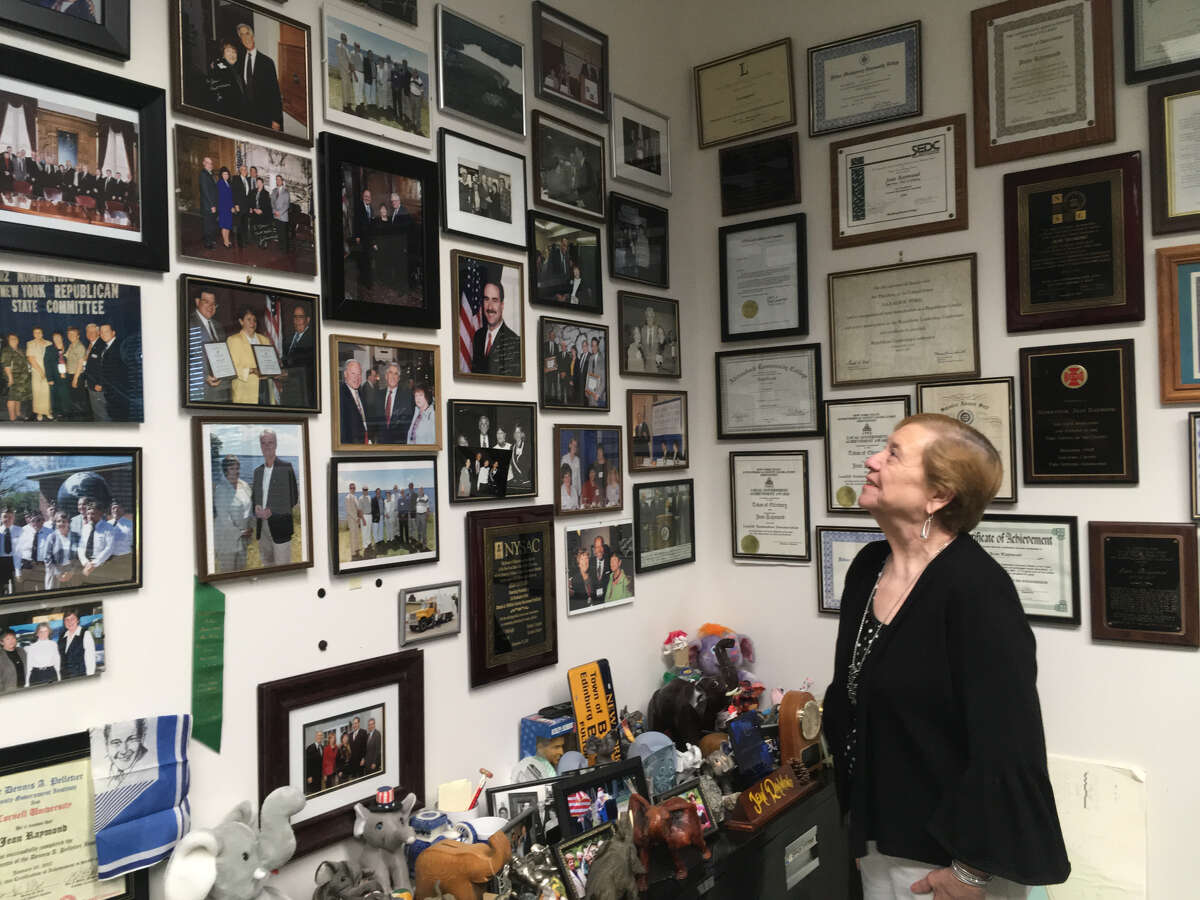 Edinburg Supervisor Jean Raymond looks at the collection of framed photos in her office at Town Hall on Aug. 21, 2019. The photographs span her 32 years in office. (Wendy Liberatore/Times Union)