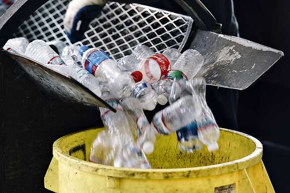 Plastic bottles are stopped into a can at Our Planet Recycling in San Francisco, Calif, on Tuesday, August 6, 2019.