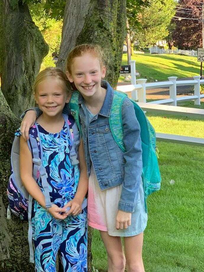 Maggie, left, first grade, and Caitlin, third grade, Martin on their first days at Hindley Elementary School, Aug. 30. Photo: Contributed
