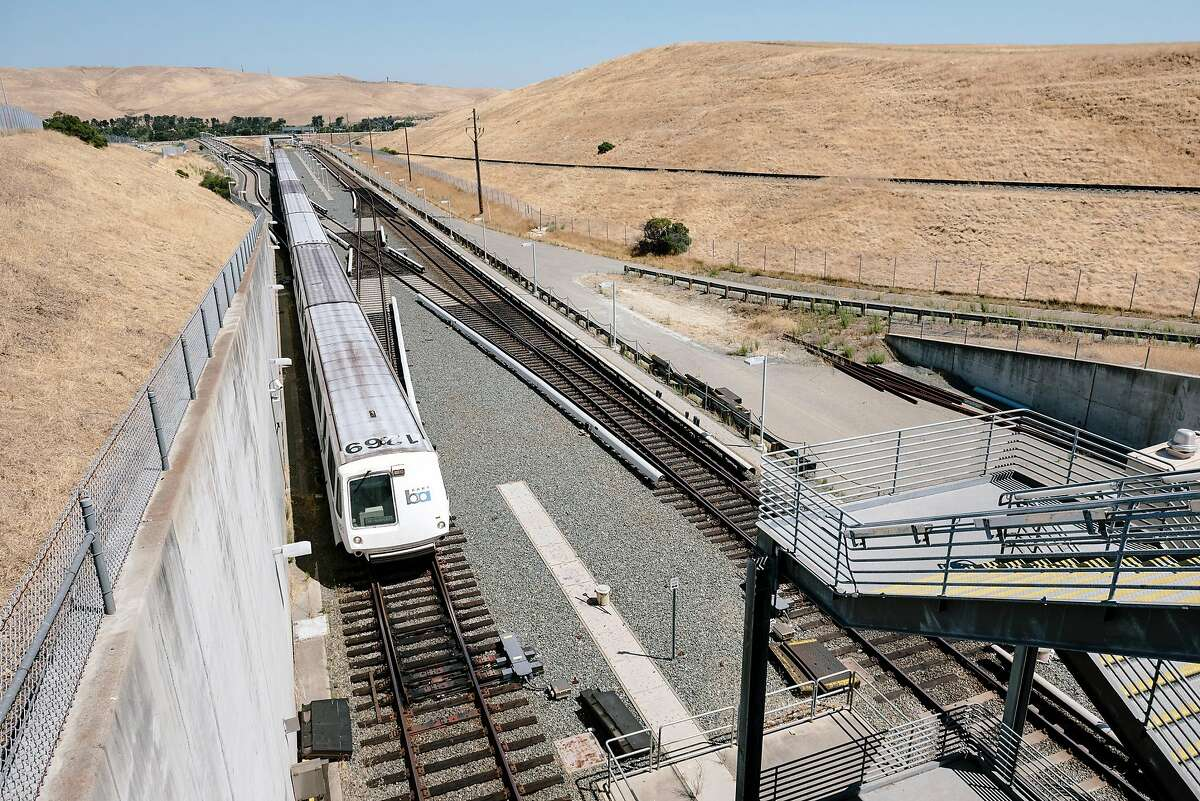 A train makes it's way into the North Concord station, next to the Concord Naval Weapons Station, at right, in Concord, Calif, on Thursday, August 29, 2019.
