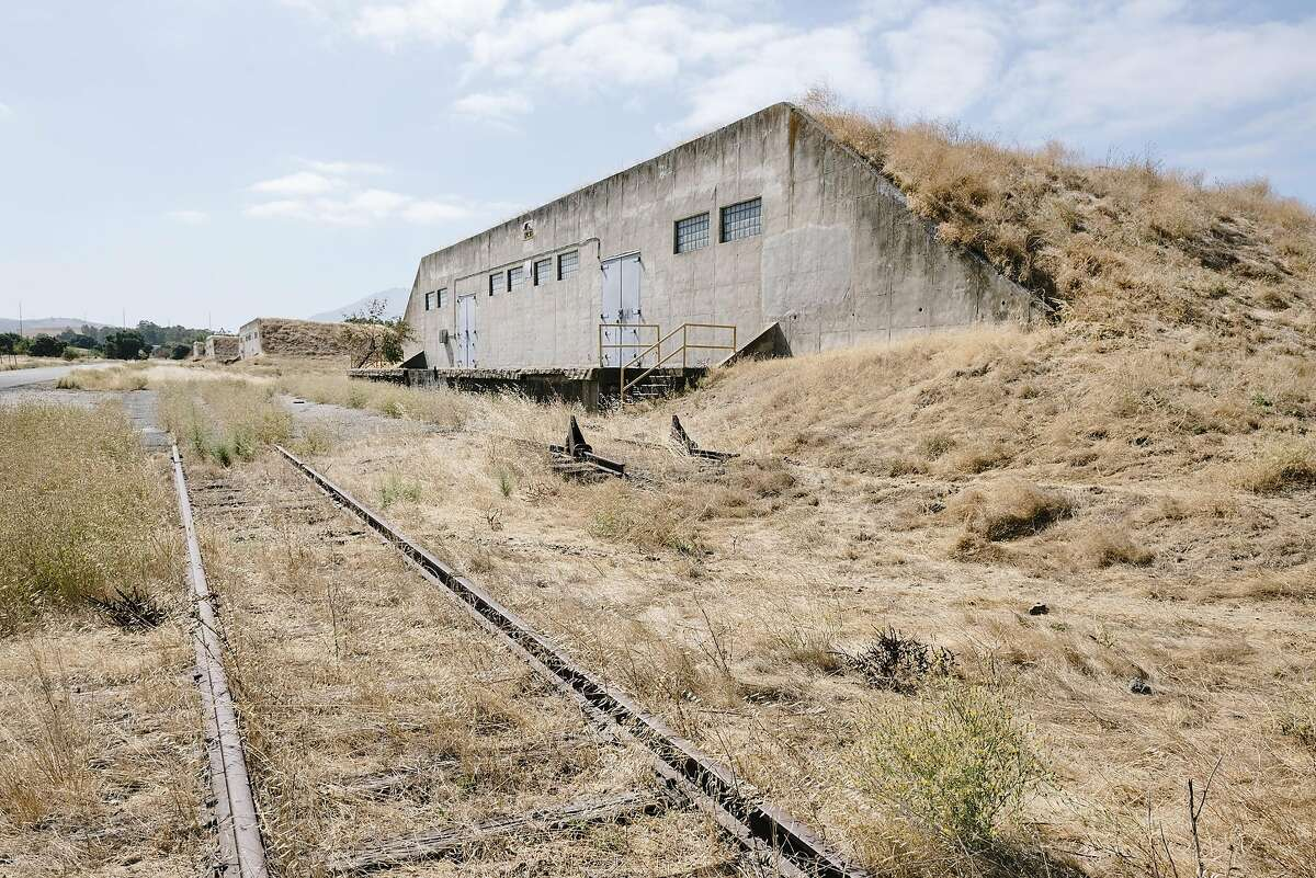 Former ammunition bunkers dot the land scape in