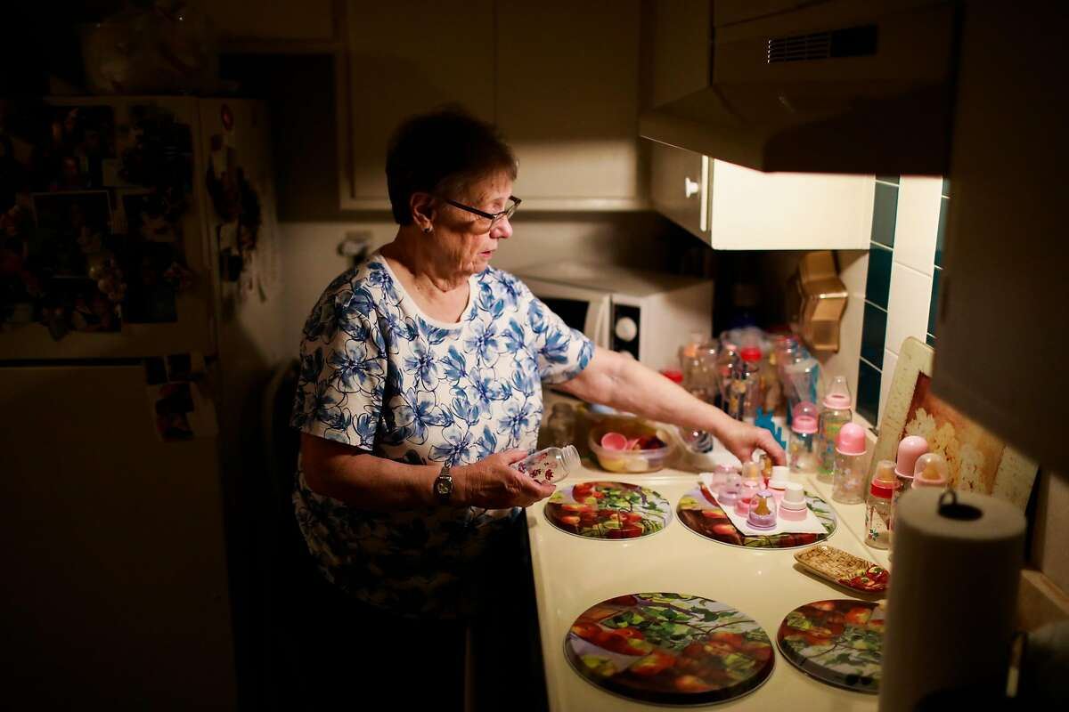 Linda Owens sorts baby bottles in her apartment in Hayward, California, on Tuesday, Aug. 20, 2019. Linda, who is a foster mother, is facing a massive rent increase after her apartment complex was bought out by a real estate developer that is converting it into affordable housing. Linda has fostered 80 babies.