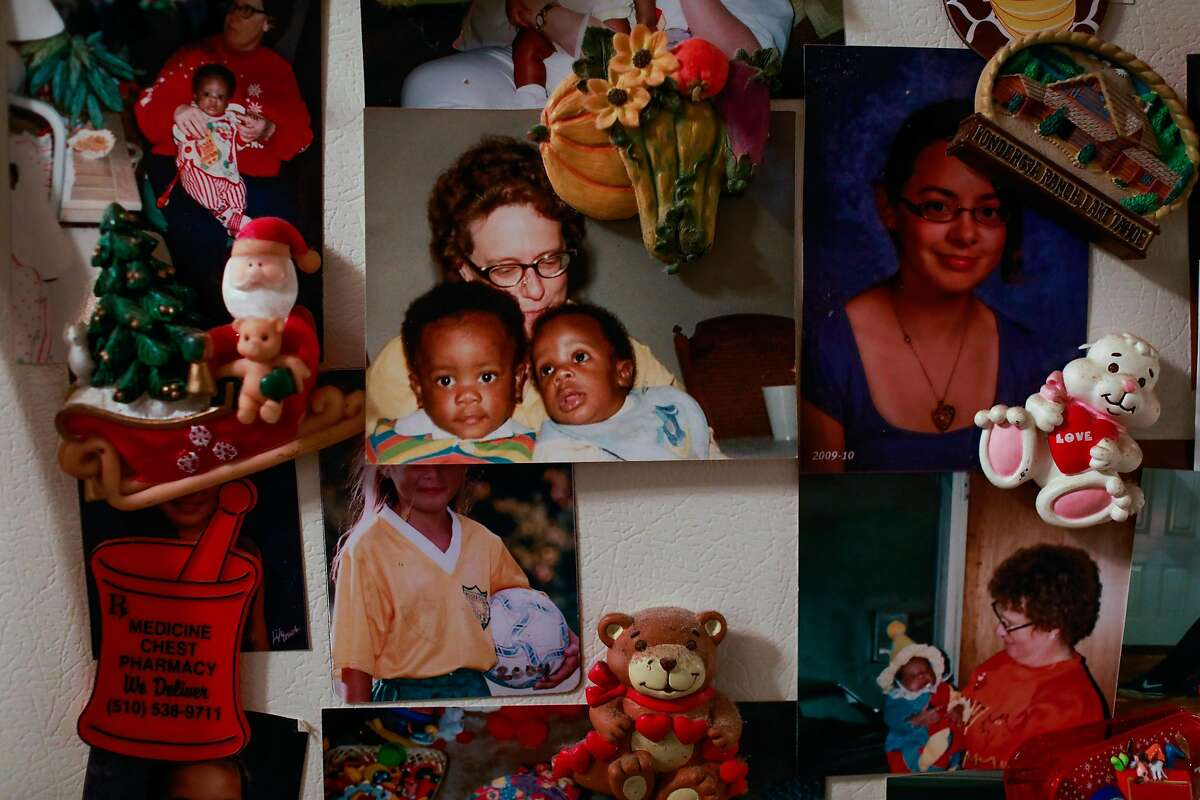 Linda Owens' refrigerator is covered with photographs of her and the children she has fostered over the years in her apartment in Hayward, California, on Tuesday, Aug. 20, 2019. Linda, who is a foster mother, is facing a massive rent increase after her apartment complex was bought out by a real estate developer that is converting it into affordable housing. Linda has fostered 80 babies.