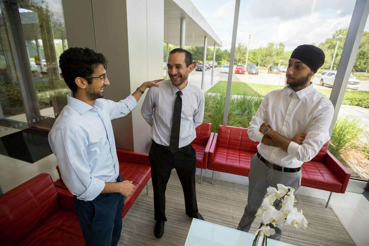 ElecTrip co-founder Mandeep Patel, left to right, chats with ElecTrip drivers Joffre Camacho and Simran Singh at the Shell Woodcreek Complex in Houston, Friday, July 19, 2019. Shell has tapped Houston electric vehicle startup ElecTrip to provide rides to company employees traveling to and from Austin and other Texas cities.