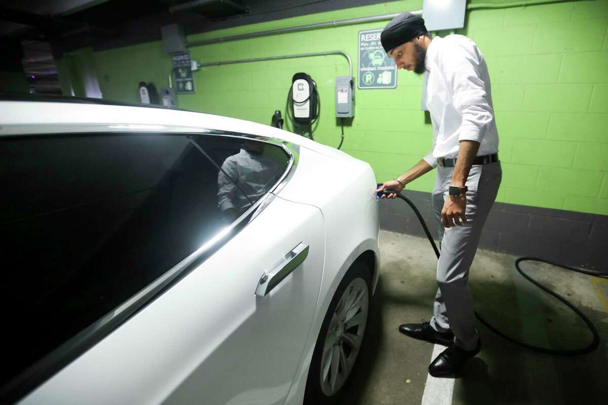ElecTrip driver Simran Singh charges his Tesla Model S in Houston, Friday, July 19, 2019.