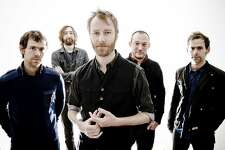 In this publicity image released by 4AD, the band The National, from left, Aaron Dessner, Bryan Devendorf, Matt Berninger, Scott Devendorf, Bryce Dessner are shown. (AP Photo/4AD, Keith Klenowski)