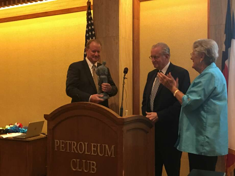 Jay Isaacs, left, received the 2019 Distinguished Citizen of the Permian Basin Award from the Buffalo Trail Council of the Boy Scouts of America during a dinner Thursday at the Petroleum Club. Isaacs, president of FirstCapital Bank, was introduced by Norbert Dickman, the 2018 honoree, center, and Rosalind Redfern Grover. Photo: Courtesy Photo