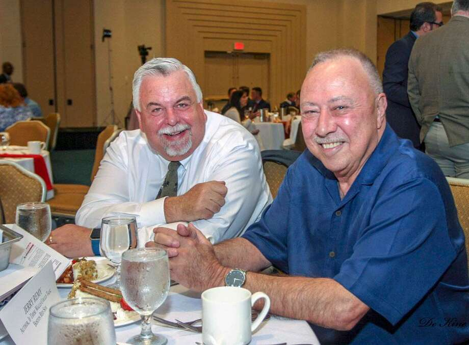 NESN broadcaster Jerry Remy spoke at the Middlesex County Chamber of Commerce author luncheon Wednesday afternoon. From left are Chamber Chairman and event sponsor, DATTCO President Don DeVivo and Remy, a former MLB player. Photo: Courtesy De Kine Photo