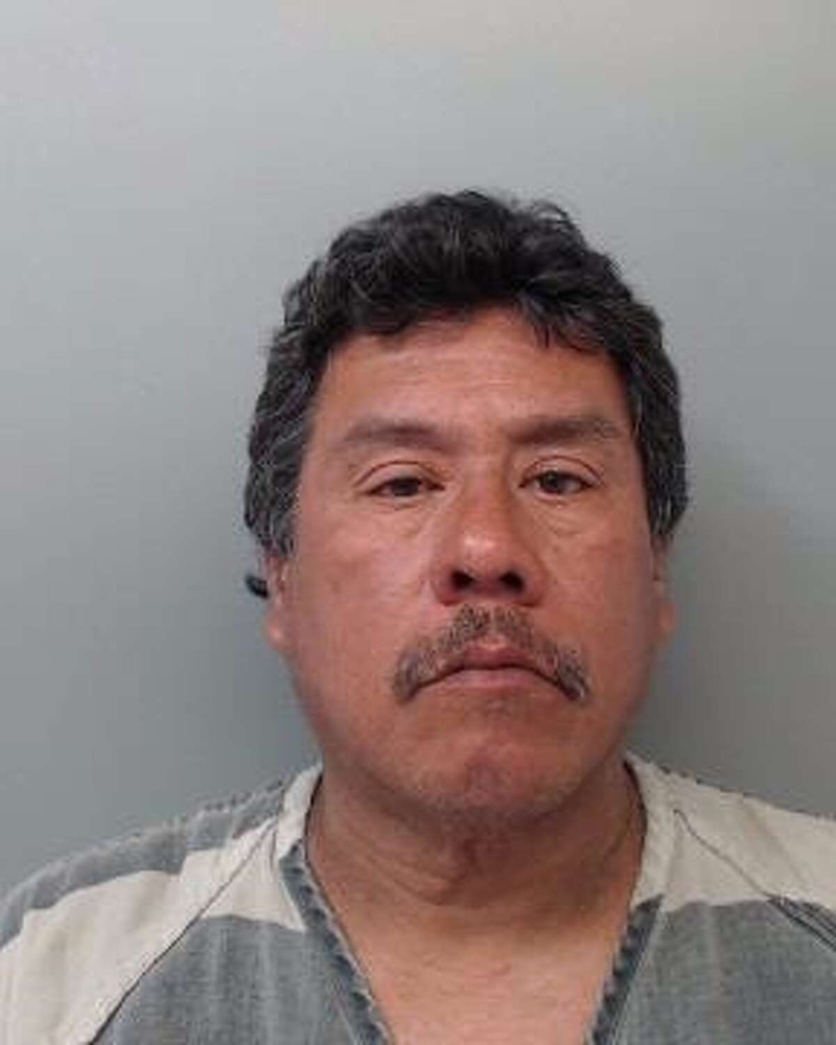 Rene Alvarado, 54, was arrested and charged with assault, family violence.