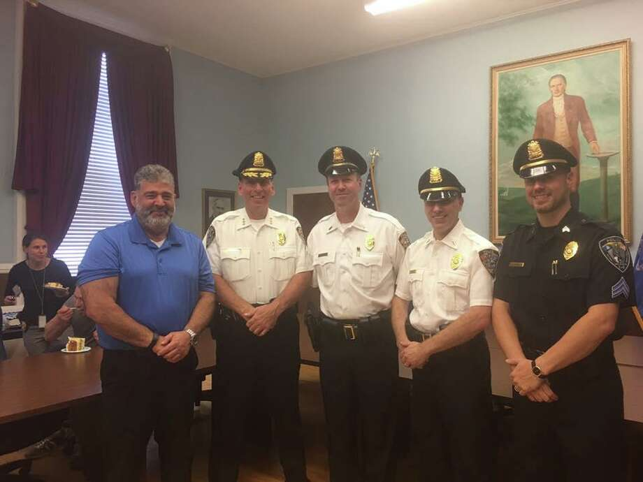 New Milford Mayor Pete Bass and Police Chief Spencer Cerruto with newly promoted officers Lt. Wheeler, Lt. Grabner and Sgt. Lafond. Photo: Contributed Photo /Facebook