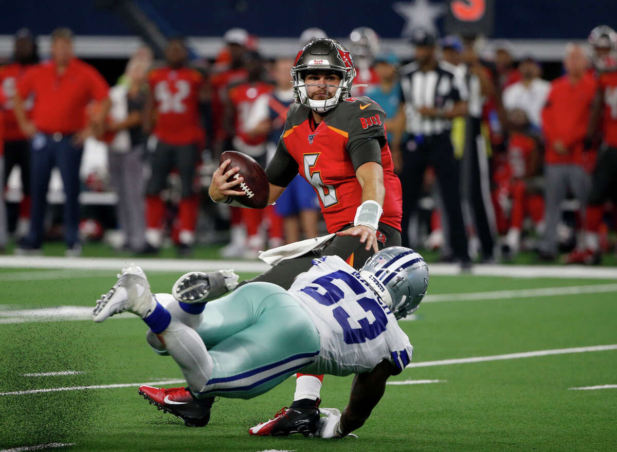 Tampa Bay Buccaneers quarterback Vincent Testaverde (6) is sacked by Dallas Cowboys linebacker Justin March-Lillard (53) in the second half of a preseason NFL football game in Arlington, Texas, Thursday, Aug. 29, 2019.
