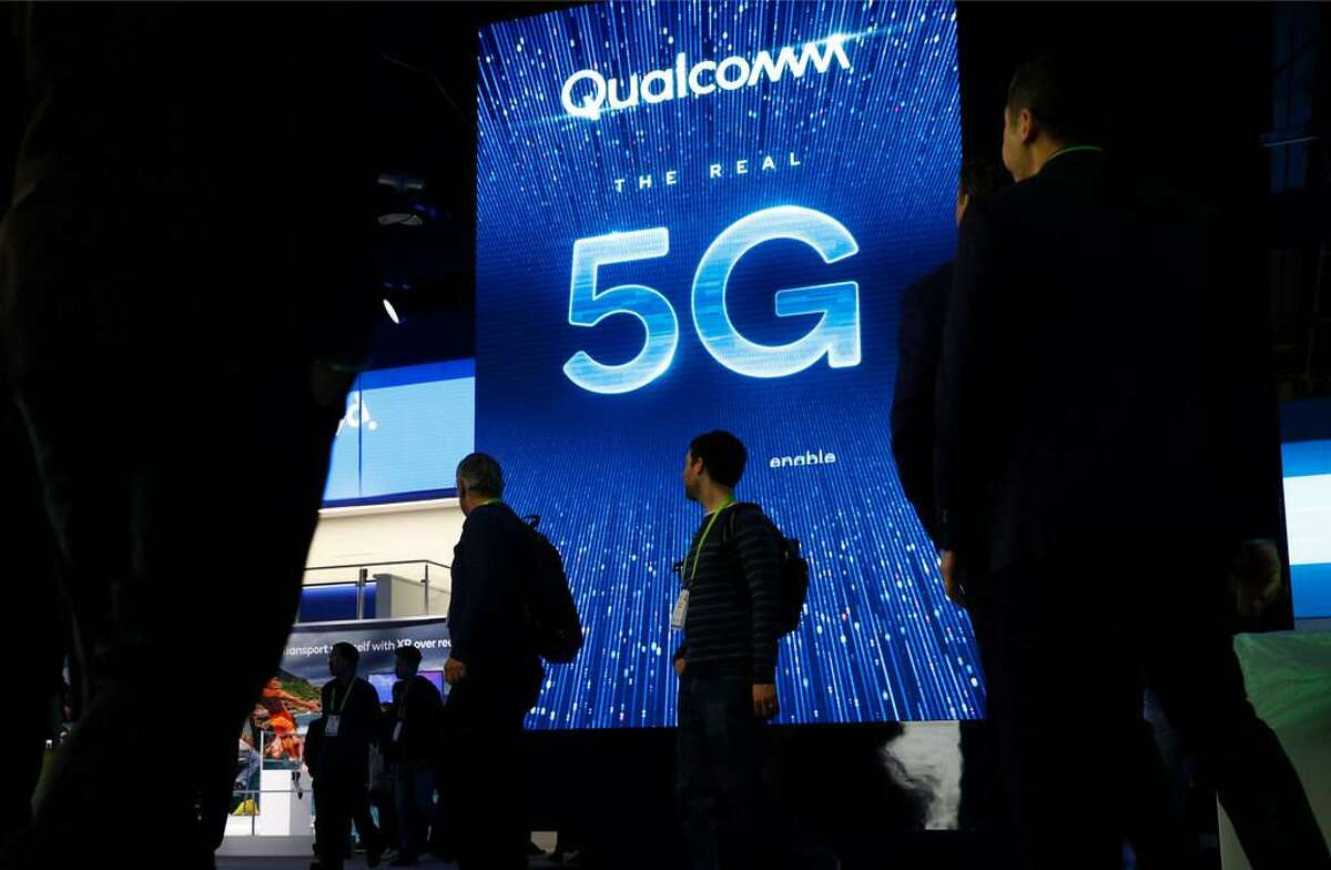A sign advertises 5G at the Qualcomm booth at CES International in Las Vegas in January.