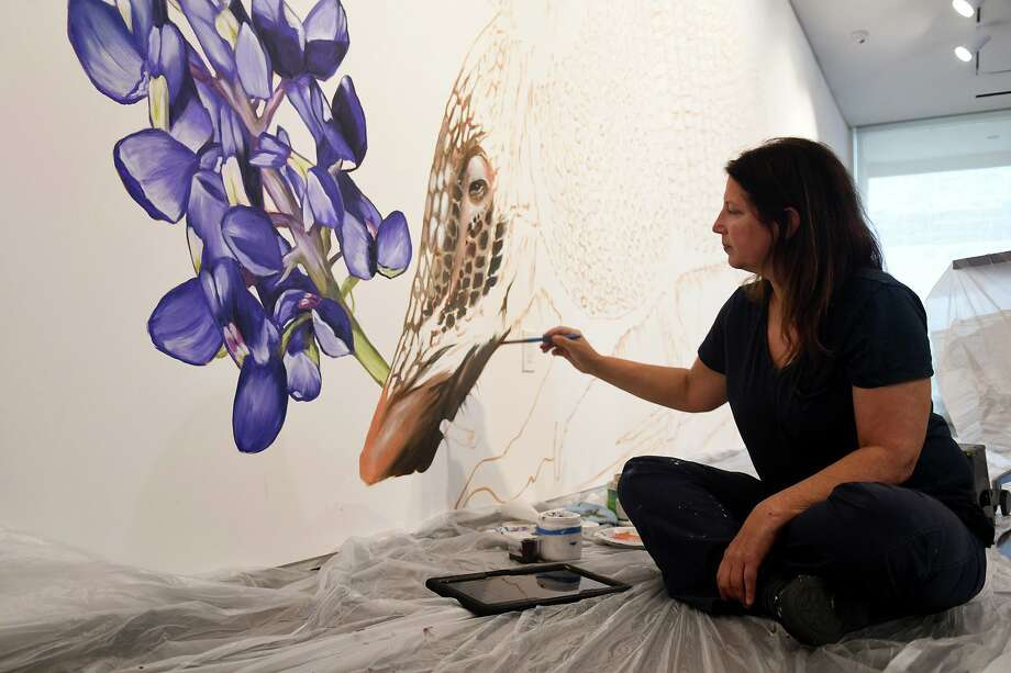 Anat Ronen, a highly regarded street artist, works on her two site-specific murals at the Pearl Fincher Museum of Fine Arts in preparation for an exhibition that opened Aug. 28, 2019. Photo: Jerry Baker, Houston Chronicle / Contributor / Houston Chronicle