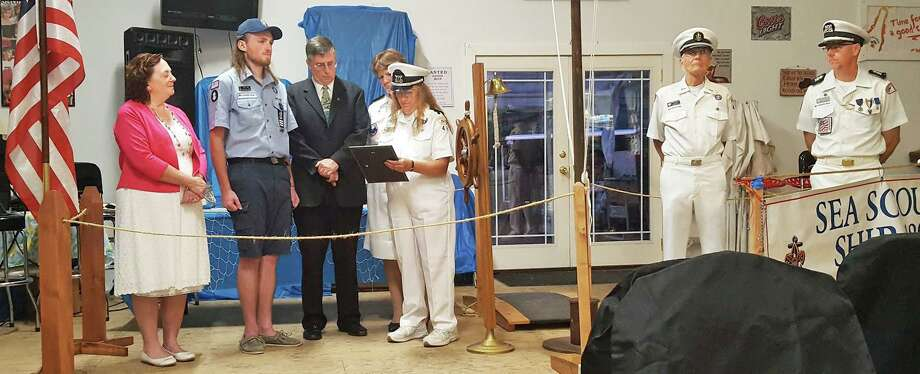 Jonathan Shaw, 21, of Middletown, second from left, a member of the Sea Scouts Ship 480 in Portland, earned the highest possible rank earlier this month. His parents Kay, left, and Bill Shaw, third from left, took part in the pinning ceremony. Photo: Contributed Photo