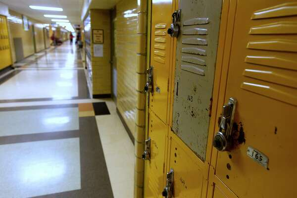 Lockers in a hallway at Vidor High School on Tuesday. Vidor ISD is proposing a $73.5 million bond issue to build a new high school and use the current campus for the junior high school. Photo taken Tuesday 4/11/17 Ryan Pelham/The Enterprise