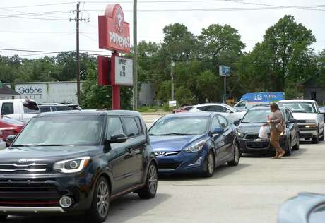 The drive-thru lane at Popeye's in Fort Walton Beach, Florida extended onto a main road on Friday Aug. 23, 2019 as most people were waiting to try the new chicken sandwich. People are choosing sides and beefing over chicken, thanks to Popeyes' release of its crispy chicken sandwich and the social media debate that has followed. With just one addition to a fast-food menu, the hierarchy of chicken sandwiches in America was rattled, and the supremacy of Chick-fil-A and others was threatened.