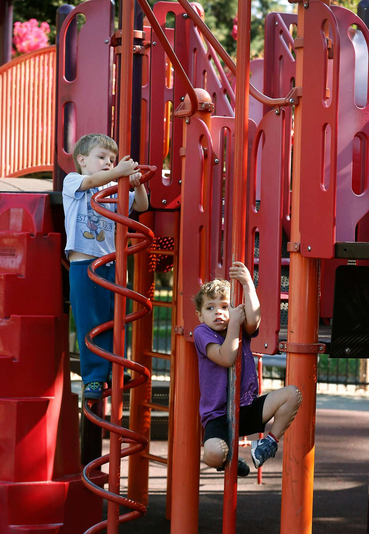 Finnegan Webster (left), 4, and Sebastian Kilgore, 3 1/2, climb on the play structure in the playground at Fuller Park in Napa, Calif. on Friday, Aug. 30, 2019. Jim Roberts and his team of volunteers from the local Kiwanis Club are constructing their 73rd playground on Sept. 7 at Playground Fantastico park.