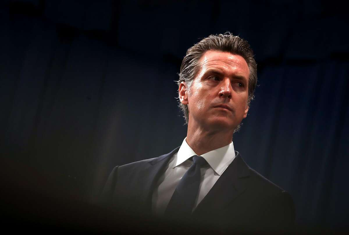 SACRAMENTO, CALIFORNIA - AUGUST 16: California Gov. Gavin Newsom looks on during a news conference with California attorney General Xavier Becerra at the California State Capitol on August 16, 2019 in Sacramento, California. California attorney genera Xavier Becerra and California Gov. Gavin Newsom announced that the State of California is suing the Trump administration challenging the legality of a new