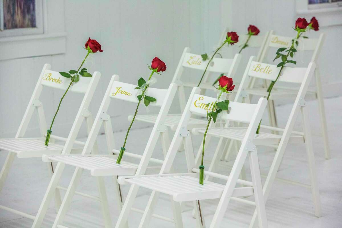 Roses on chairs with the names of those killed during the shooting at First Baptist Church in Sutherland Springs, Texas, which has been transformed into a memorial to honor those who died, Nov. 12, 2017. After a gunman killed 26 at the Baptist church one week ago, parishioners gathered at a nearby baseball field to worship with their pastor, whose daughter was among the dead. (Drew Anthony Smith/The New York Times) ORG XMIT: XNYT31