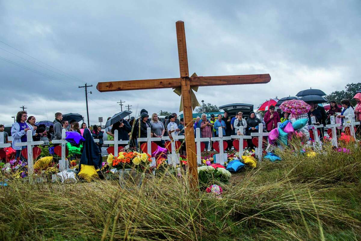 People gather in front of crosses at First Baptist Church in Sutherland Springs, Texas, which has been transformed into a memorial to honor those who died, Nov. 12, 2017. After a gunman killed 26 at the Baptist church one week ago, parishioners gathered at a nearby baseball field to worship with their pastor, whose daughter was among the dead. (Drew Anthony Smith/The New York Times) ORG XMIT: XNYT40