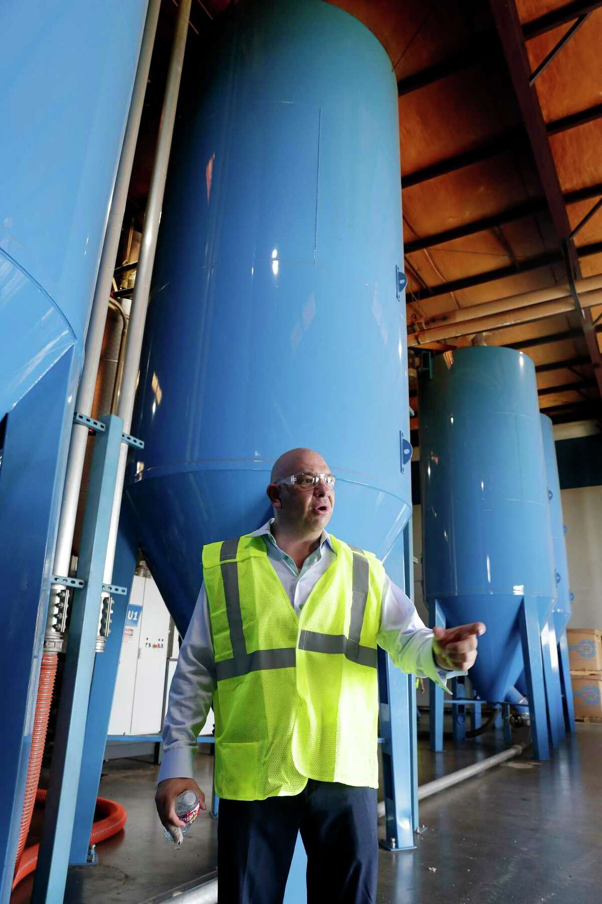 CEO Rick Perez in front of silos containing newly processed recycled plastic pellets at the Avangard Innovative recycling facility and company headquarters Wednesday, Aug. 28, 2019 in Houston, TX.